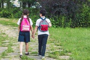rear view of schoolchildren walking