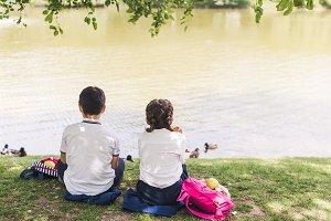 rear view of schoolchildren sitting