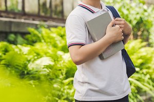 smiling schoolboy with backpack and