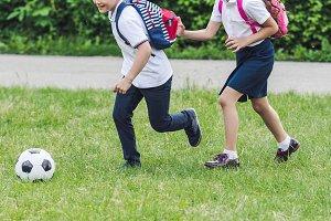 active schoolchildren playing soccer