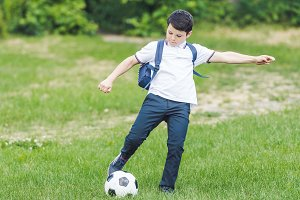 active kid playing with soccer ball