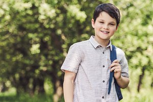 smiling schoolboy with backpack look