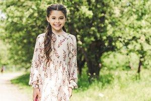 beautiful child in stylish dress loo