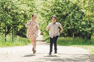 happy kids having fun and running in