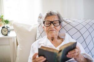 Sick senior woman with glasses
