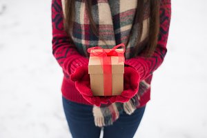A girl holding a gift in her hands