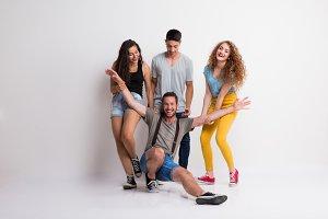 Portrait of joyful young group of