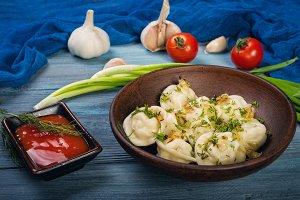 Dumplings in clay plate