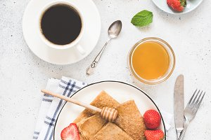 Tasty breakfast with coffee, crepes