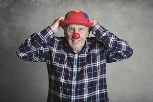 grandfather with hat and clown nose