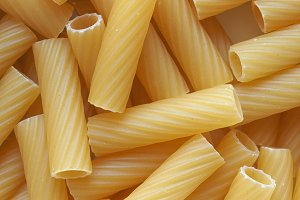 tortiglioni pasta food background