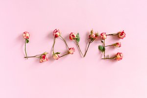 Word Love laid out of roses