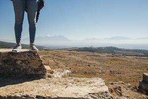 Female tourist feet in ancient ruins