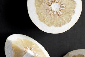 Fresh pomelo citrus cut into pieces