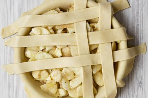 Cooking apple pie on a white wooden