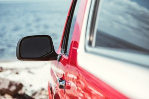 selective focus of car mirror, red j