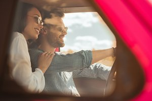 beautiful happy couple driving car t