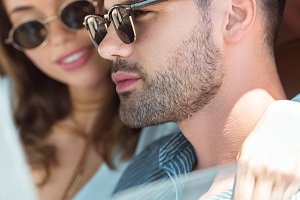 beautiful young couple in sunglasses