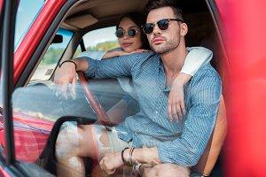 beautiful couple in sunglasses sitti