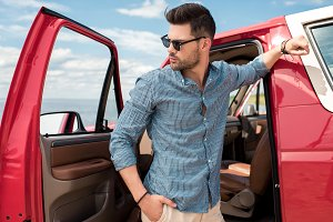 handsome stylish traveler standing n