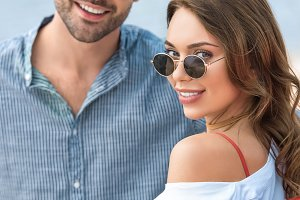 smiling young couple in sunglasses p
