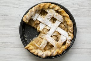 Home-baked apple pie on white wooden