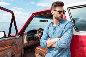 handsome stylish male traveler stand