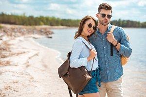beautiful happy couple in sunglasses