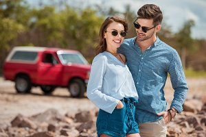 young smiling couple in sunglasses h