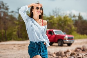 cheerful young woman in sunglasses o