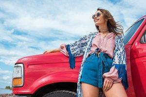 cheerful stylish young woman posing
