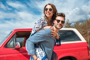 young smiling couple in sunglasses p