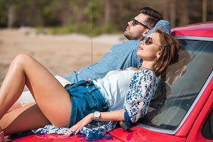beautiful young couple sunbathing to