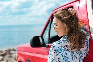 beautiful stylish woman at car durin