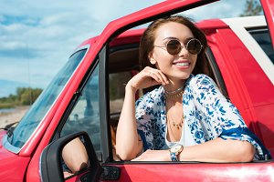 smiling young woman in sunglasses in
