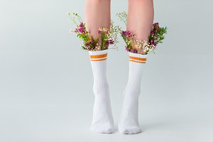 partial view of female legs in socks