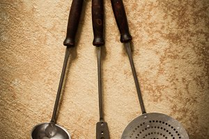 Old vintage ladle and fork for meat
