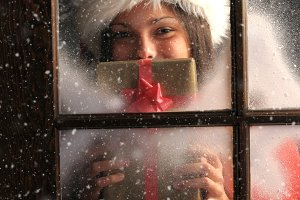 Girl Window with Christmas Present