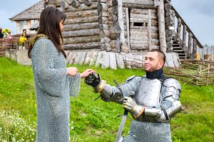 A knight in armor gives chamomile to