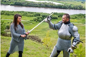 A lady in chain mail and a knight in