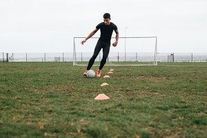 Soccer player practicing dribbling