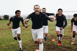 Soccer players screaming in joy