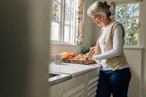 Senior woman working in kitchen