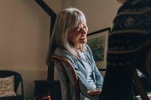 Senior woman sitting on chair