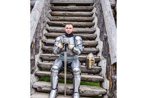 Knight in the armor on the wooden