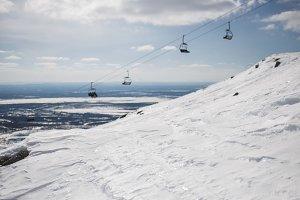 Shiny snow with blurred ski-lift