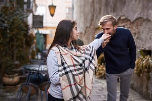 man kisses a woman's hand. Happy