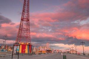 Boardwalk in coney island at sunset