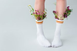 cropped shot of young woman in socks
