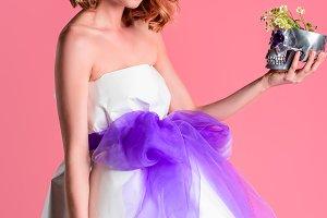 beautiful young woman holding decora